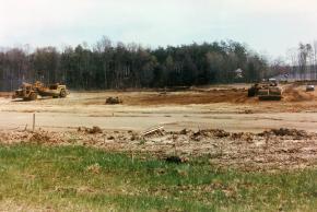Photograph of the construction site of the new Centreville Elementary School, circa 1993. Large construction equipment has cleared the school site to bare earth and the site is being graded.